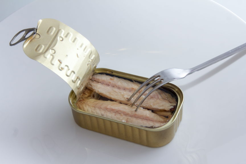 tin of mackerel with fork inside it