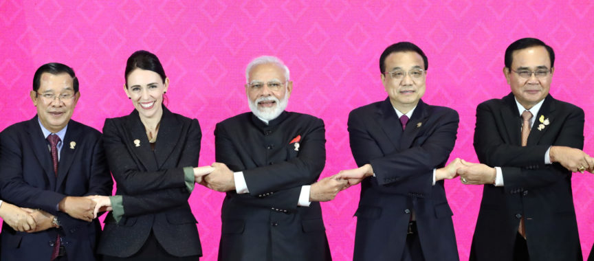 world leaders link arms at trade deal signing