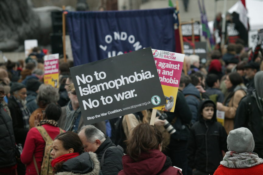 a protest at which someone holds the banner 'no to Islamophobia, no to war'