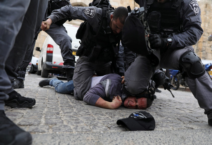 Police detain a Palestinian protester in Jersualem.