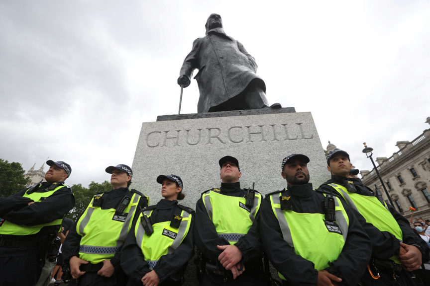 Policeofficers guard a statue of WinstonChurchillas people take part in a Black Trans Lives Matter rally in London, Britain, June 2020. Simon Dawson/Reuters