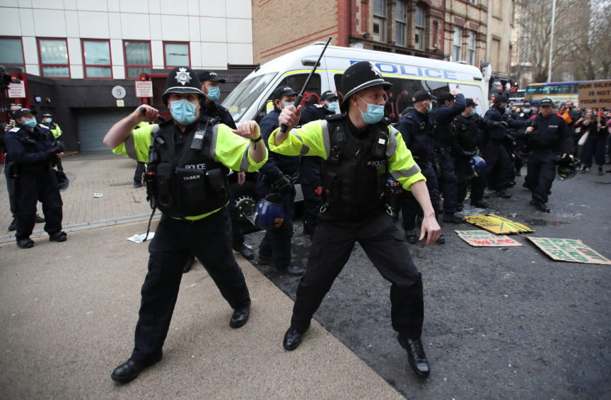 Police officers stand guard during a protest against a new proposed policing bill, in Bristol, Britain