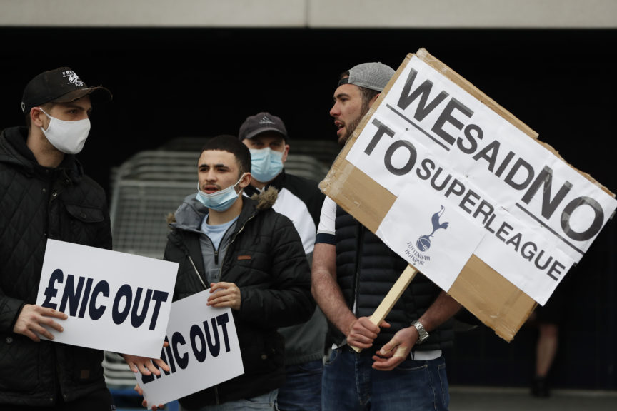 Football fans protest the proposed European Super League.