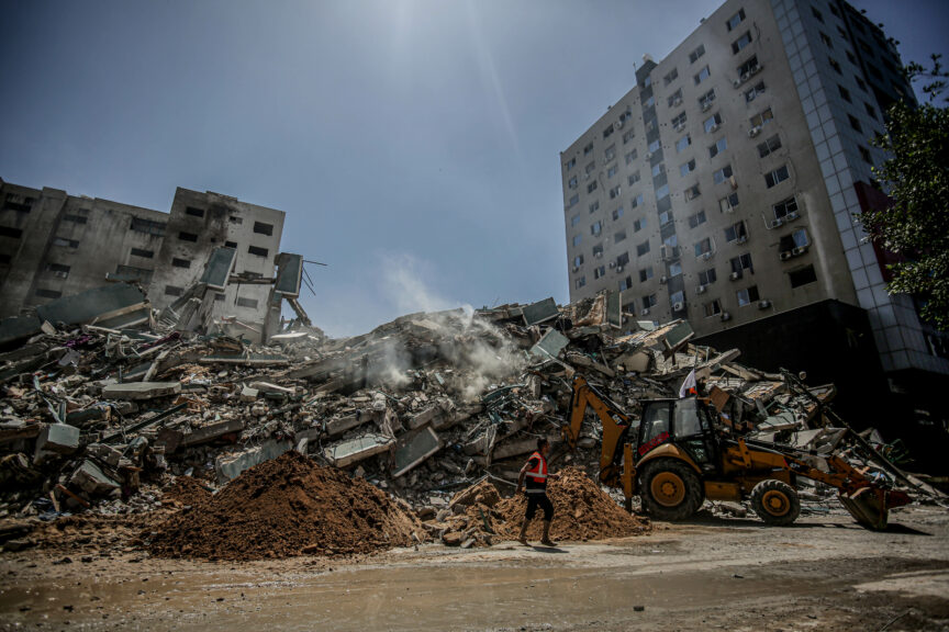 A Palestinian municipal worker cleans up a pile of rubble in Gaza following the ceasefire agreement between Israel and Hamas, May 2021. Yousef Masoud/Reuters