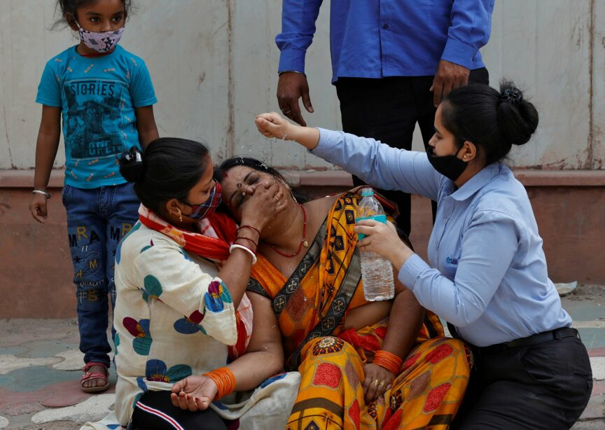 A woman is consoled outside a mortuary after her husband dies from Covid-19, New Delhi, April 2021. Ninian Reid/Flickr