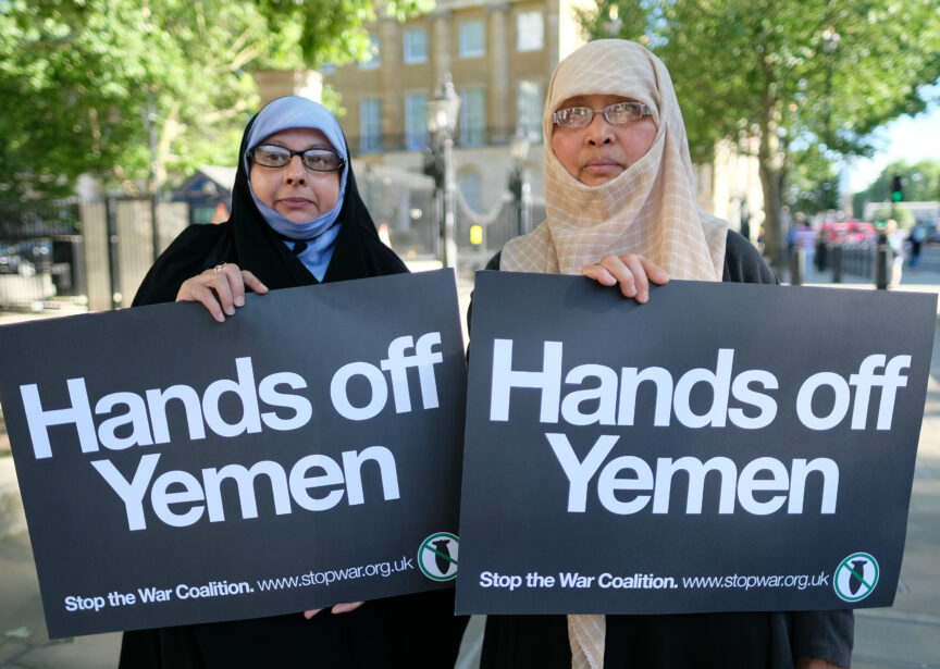 Two activists stand opposite 10 Downing Street in protest at the UK's involvement in Saudi Arabia's war on Yemen, June 2018. Alistair Hickson/Flickr
