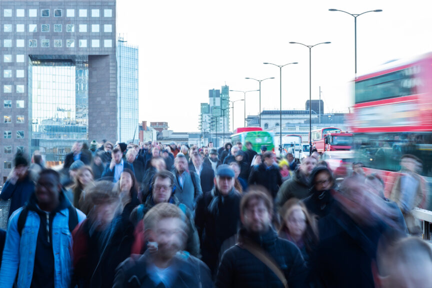 Commuters in London with blurred faces