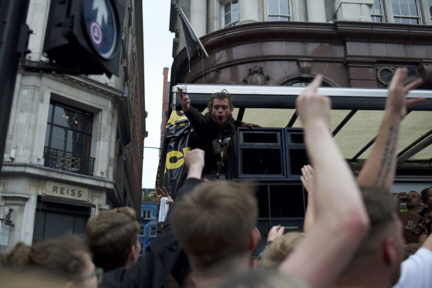 A crowd cheers at London's rave protest