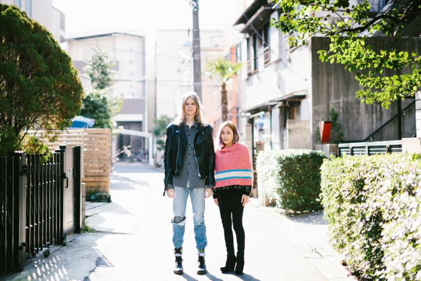 Elin McCready and her wife, Midori Morita-McCready, standing side-by-side in a street in Japan.