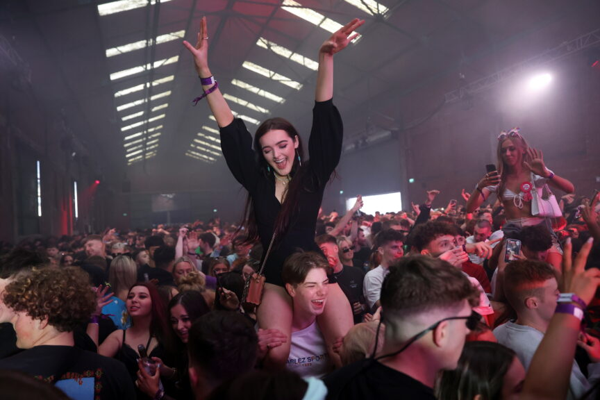 nightclub coronavirus pilot scheme girl with hands in the air partying clubs