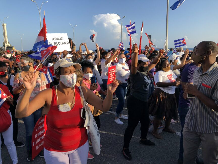 Cubans take part in a mass rally in defence of the Cuban Revolution and calling for an end to US sanctions